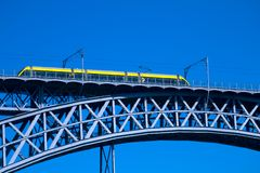 Modern tram on a steel bridge Stock Photo