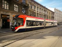 Modern tram on the street royalty free stock images
