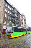 Modern tram on a street of Poznan Stock Photo