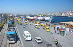 Modern Tram,taxis,cars,vans and ferries carrying people all day between two sides Stock Image