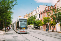 Modern tram Tussam on the line in Seville, Spain Stock Photography