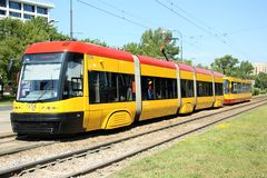 Modern tram in Warsaw, Poland. Modern low-floor tram in Warsaw, the capital of Poland. Currently, the Tramwaje Warszawskie (Warsaw Trams) company runs about 865 Stock Photo