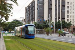 Modern trams in the streets stock photos