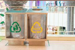 Modern transparent containers with signs for separate garbage waste in the mall. Waste separate collection system. Modern transparent containers with signs for royalty free stock photo