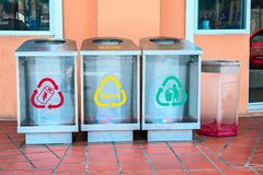 Modern transparent containers with signs for separate garbage and biodegradable waste. Urban waste separate collection system. stock photo