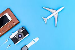 Modern Travel objects for world travel concept on blue. Background Stock Photography