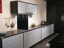Modern trendy design black and white kitchen. Modern design trendy kitchen with black and white wood elements and metal Royalty Free Stock Photos