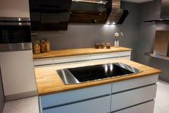 Modern trendy design white wooden kitchen. Modern design trendy kitchen with white and wood elements Royalty Free Stock Photos
