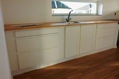 Modern trendy design white wooden kitchen. Modern design trendy kitchen with white and wood elements Royalty Free Stock Photo