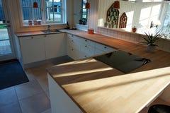 Modern trendy design white wooden kitchen. Modern design trendy kitchen with white and wood elements Royalty Free Stock Image