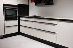 Modern trendy design wooden kitchen. Modern trendy design wooden black and white kitchen Stock Image