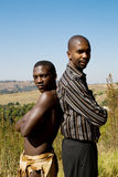 Modern and tribal african men Royalty Free Stock Images