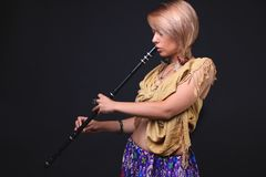 Modern Tribal Woman playing flute Royalty Free Stock Photos