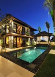 Modern tropical villa with swimming pool stock image