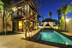 Modern tropical villa with swimming pool. Modern luxury tropical Villa with swimming pool in the nature royalty free stock images