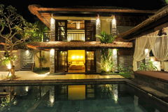 Modern tropical villa with swimming pool. Modern luxury tropical Villa with swimming pool in the nature royalty free stock photo
