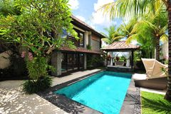 Modern tropical villa. With swimming pool in nature royalty free stock photos