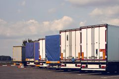 Modern trucks of various models are in a row on truck stop. stock image