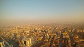 A modern Turkish city in the smoke and rays of the evening sun view from the height. KONYA / TURKEY - 11.20.2016 central streets of the ancient Turkish city stock footage