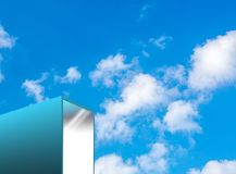 Modern turquoise building with sky. Modern turquoise cube style minimalist building with sky Royalty Free Stock Image