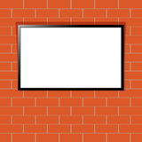 Modern TV with blank screen on red brick wall. Smart TV display mockup. Blank television template Royalty Free Stock Photos