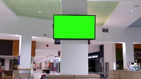 Modern TV with a green screen point of view inside food court area. At Coquitlam Center shopping mall stock footage