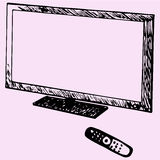 Modern TV and remote control Stock Photo