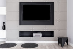 TV on wall. Modern TV screen on wall with decorative metal panels stock images
