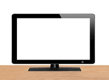 Modern TV screen on wooden table Royalty Free Stock Photos