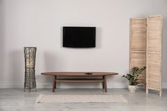 Modern TV set mounted on wall. In living room royalty free stock photos
