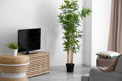 Modern TV set on stand. In living room Royalty Free Stock Photo