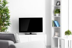 Modern TV set on stand in room. Modern TV set on stand in living room Stock Photos