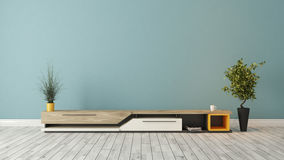 Modern tv stand with blue wall design Royalty Free Stock Image