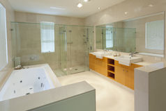 Modern twin bathroom. Modern marble bathroom with twin sinks, shower and bath tub Stock Photos