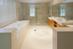 Modern twin bathroom. Modern marble bathroom with twin sinks, shower and bath tub Stock Images