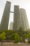 Eco building in Kuala Lumpur. Modern twin building with ecological facade in Kuala Lumpur, Malaysia Royalty Free Stock Image