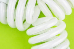 Modern twisted lightbulbs on lime green backgound Royalty Free Stock Photos