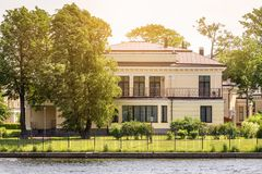 Modern two-storey house on the river royalty free stock photo
