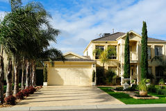 Modern two-story family house with garage. In a residential neighborhood Stock Images