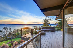 Modern two story panorama house with wraparound deck Royalty Free Stock Image