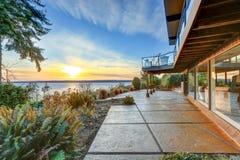 Modern two story panorama house with wraparound deck Stock Photos