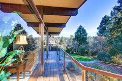 Modern two story panorama house with wraparound deck Stock Images