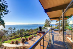 Modern two story panorama house with wraparound deck Royalty Free Stock Images