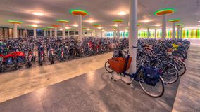 Modern underground bicycle parking. Modern underground indoor bicycle parking at a train station in the Netherlands Stock Image