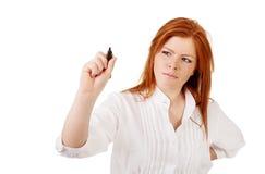 Modern ung härlig affärskvinna som pekar grafframsteg i luften Royaltyfri Fotografi