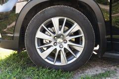 Modern unidentifiable black suv car wheel Royalty Free Stock Photo