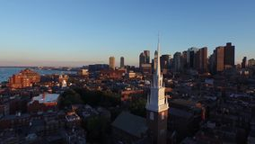 Modern urban Boston downtown district architecture skyscrapers evening sunset amazing 4k aerial drone panorama cityscape. Modern urban Boston downtown district stock footage