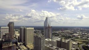 Modern urban busy cityscape panorama with tall mirror walls financial distric skyscrapers on sunne day in 4k aerial shot stock footage
