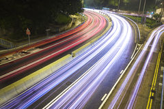 Modern Urban City with Freeway Traffic at Night Royalty Free Stock Images