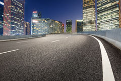 The modern urban commercial building and asphalt road Royalty Free Stock Photos